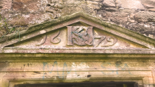 Dalquharran Castle showing 17th century extension entrance with monogram, date and Latin inscription.